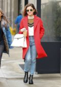 Lucy Hale wears a red coat as she leaves her hotel holding an iced coffee in New York City