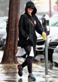 Minka Kelly leaves the gym in a black hoodie on a rainy day in West Hollywood, Los Angeles