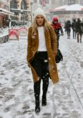 Mollie King spotted while running errands in a snow blizzard in London