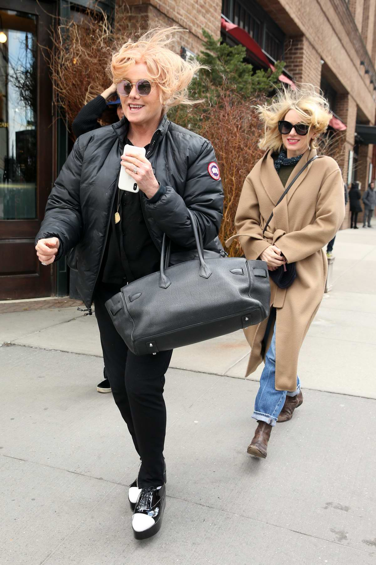 Naomi Watts and Deborra-Lee Furness spotted while leaving Greenwich Hotel on a windy day in New York City