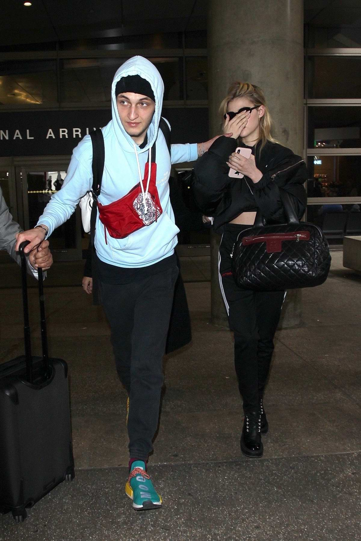 Nicola Peltz and Anwar Hadid touches down at LAX airport in Los Angeles
