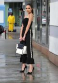 Olivia Culpo looks chic in matching GRL PWR strapless black top and a flared pant while on her way to dinner in Santa Monica, California