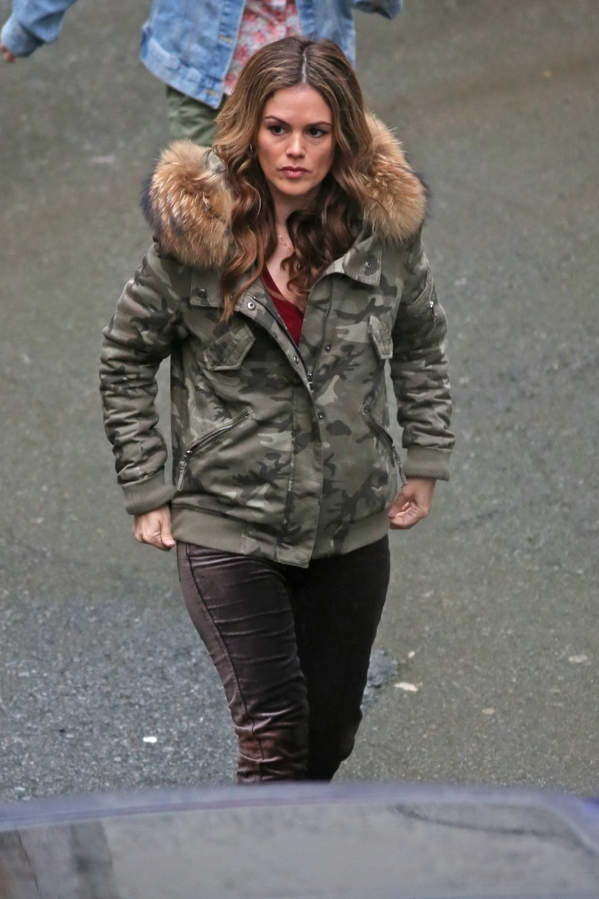 Rachel Bilson keeps warm in a fur trimmed camo parka while working in Vancouver, Canada