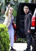 Rita Ora hops into her ride with boyfriend Andrew Watts as she leaves a recording studio in Westwood, California
