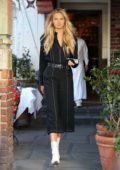 Romee Strijd wears a black jumpsuit paired with white boots while out for lunch at The Ivy and then on shopping at Chanel in West Hollywood, Los Angeles