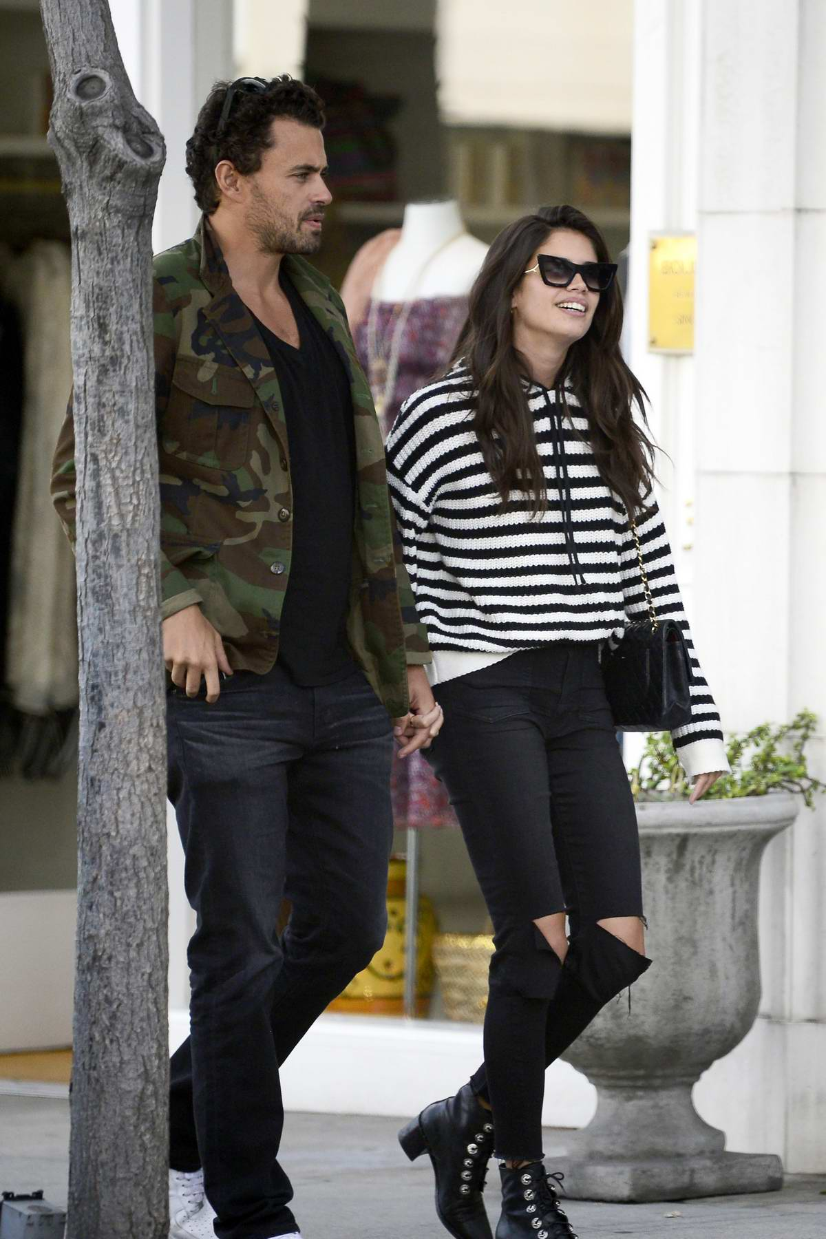 Sara Sampaio and boyfriend Oliver Ripley hold hands as they stroll around Rodeo Drive in Beverly Hills, Los Angeles
