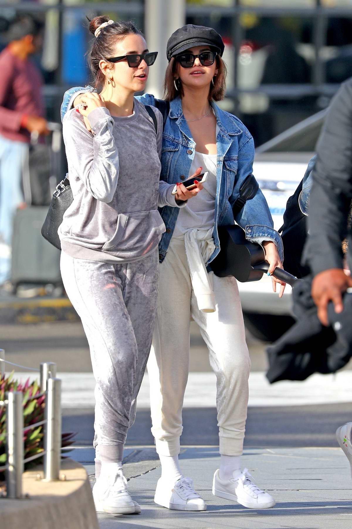 Selena Gomez arrives at Sydney airport carrying her ukulele guitar, Australia