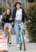 Selena Gomez enjoying a fun afternoon with her friend riding her bike around her neighborhood in Studio City, Los Angeles