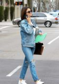 Selena Gomez is all smiles as she steps out in double denim on St. Patrick's Day in Beverly Hills, Los Angeles