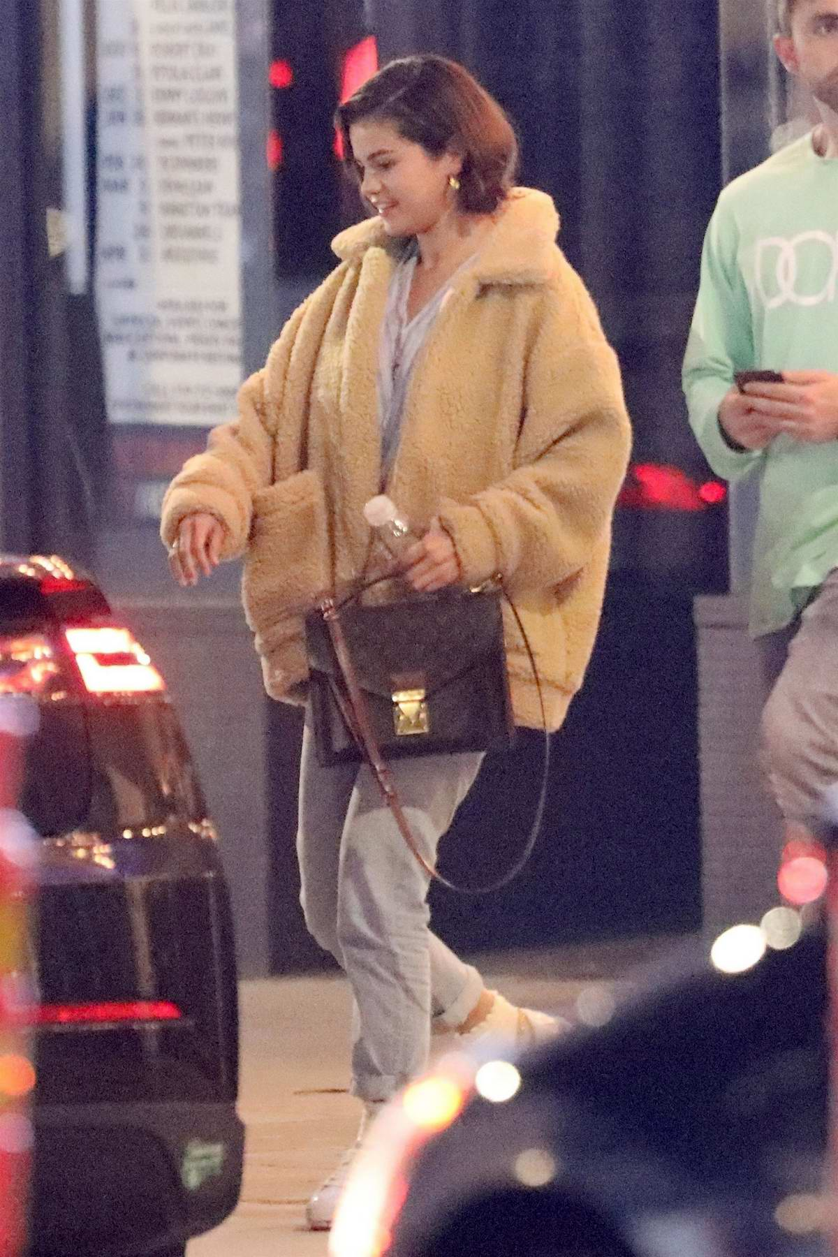 Selena Gomez spotted in a beige Sherpa jacket as she attends church service in Beverly Hills, Los Angeles