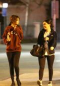 Selena Gomez wears a VOUS hoodie and leggings as she heads to a Mexican restaurant with her friend Ashley Cook in Studio City, Los Angeles