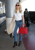 Sienna Miller sports a casual chic look as she makes her way through LAX airport, Los Angeles