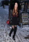 Xenia Tchoumitcheva wearing knee high boots with fur trimmed hooded jacket while out in a very chilly whether in Notting Hill, London