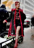 Bella Thorne steps out in a snowstorm wearing a red trimmed coat with matching red boots in New York City