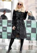 Dove Cameron ignores the snow while she pose outside AOL Build Series in New York City