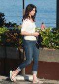 Lana Del Rey enjoys a walk along the beach with her friends in Rio de Janeiro, Brazil
