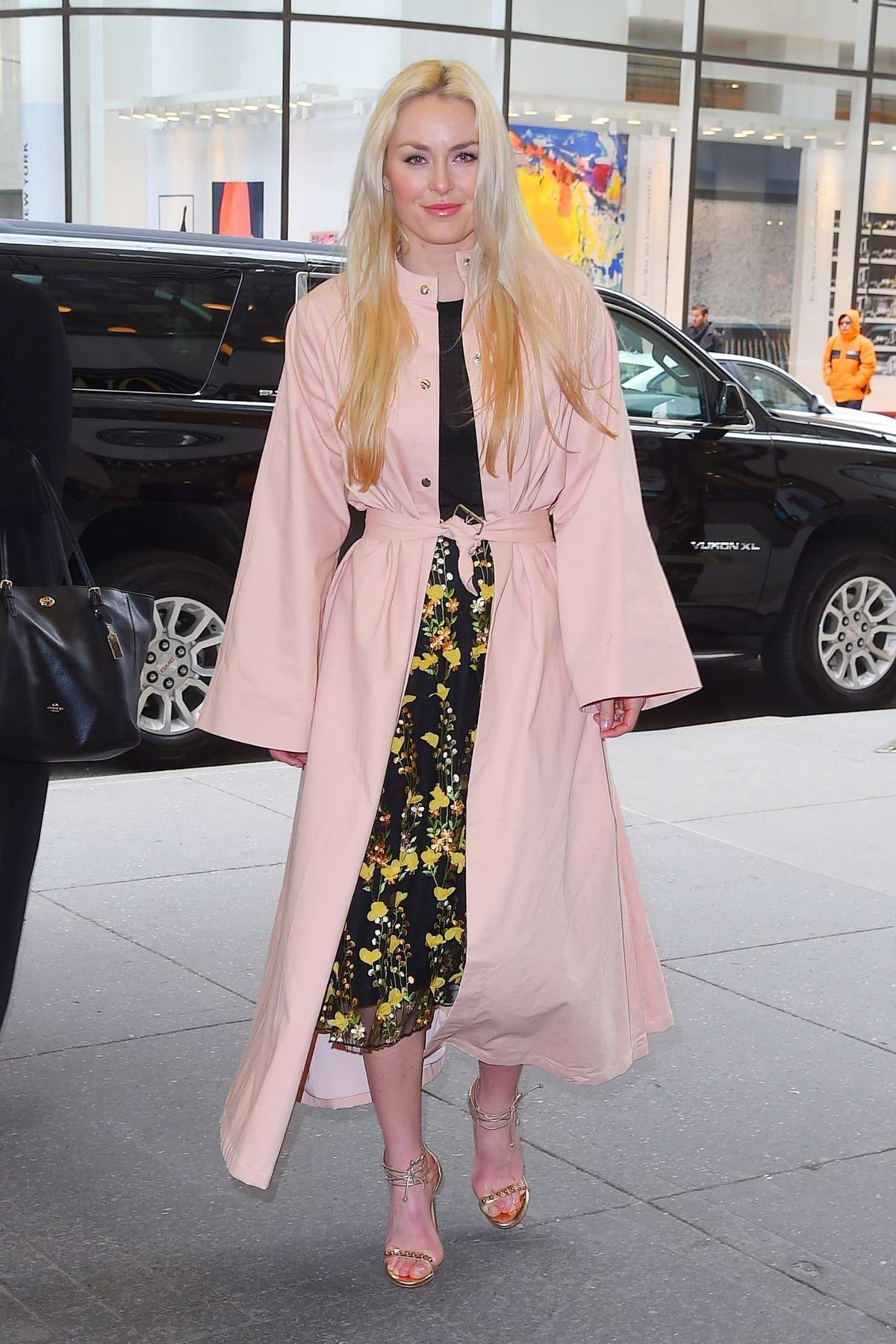 Lindsey Vonn wore a baby pink trench coat as she arrives at the 'New York Live' TV show in New York City