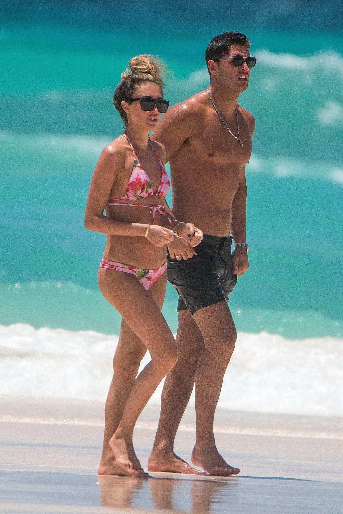 Megan McKenna wears a floral print bikini at beach with on holiday with her new boyfriend Mike Thalassitis in Barbados