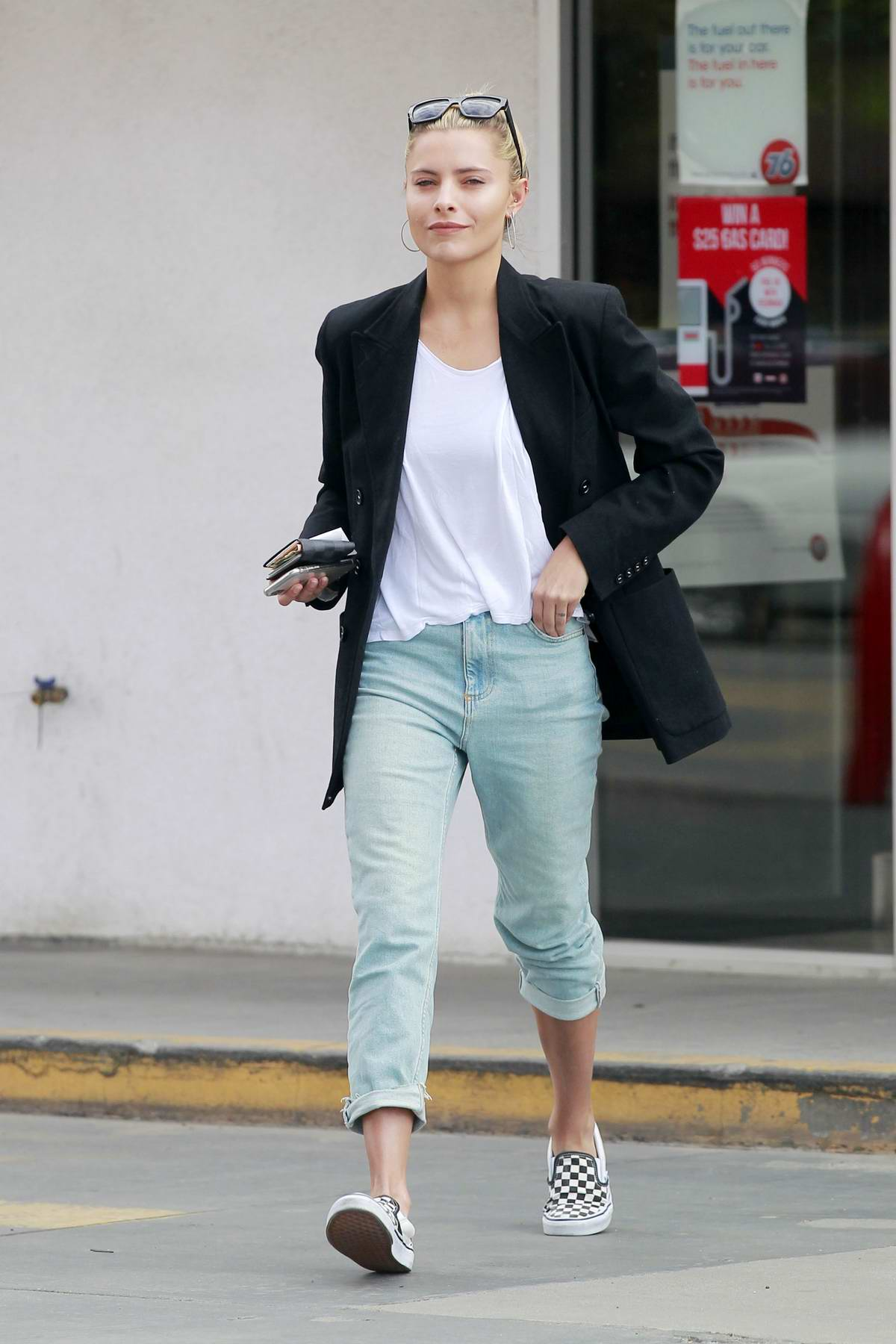 Sophia Thomalla spotted in her Aston Martin as she stop by a gas station in Los Angeles