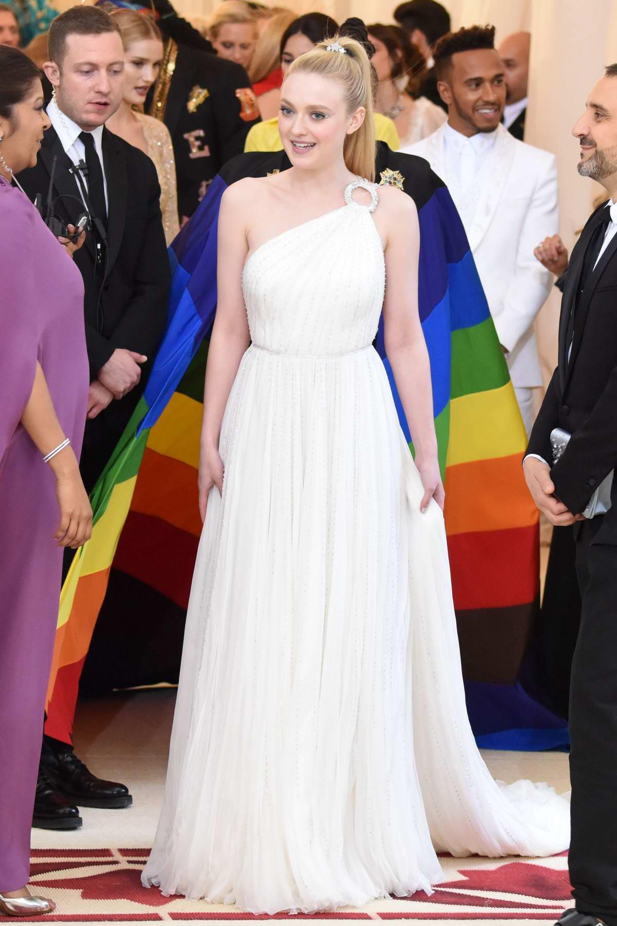 Dakota Fanning attends The Costume Institute Benefit Gala (MET Gala 2018) at Metropolitan Museum of Art in New York City