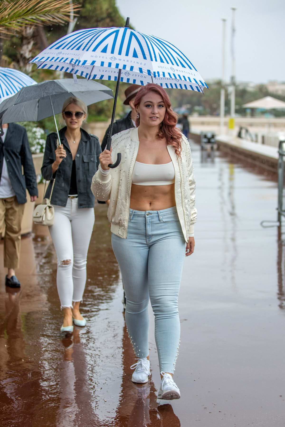 Iskra Lawrence strolls on the Croisette in rain during 71st Cannes Film Festival in Cannes, France
