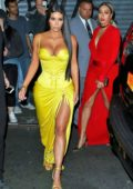 Kim Kardashian steps out for a family dinner wearing a bright yellow deep neck dress in Chinatown, New York City