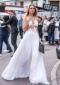 Kimberley Garner steps out in a white dress as she leaves Hotel Martinez during 71st Cannes Film Festival in Cannes, France