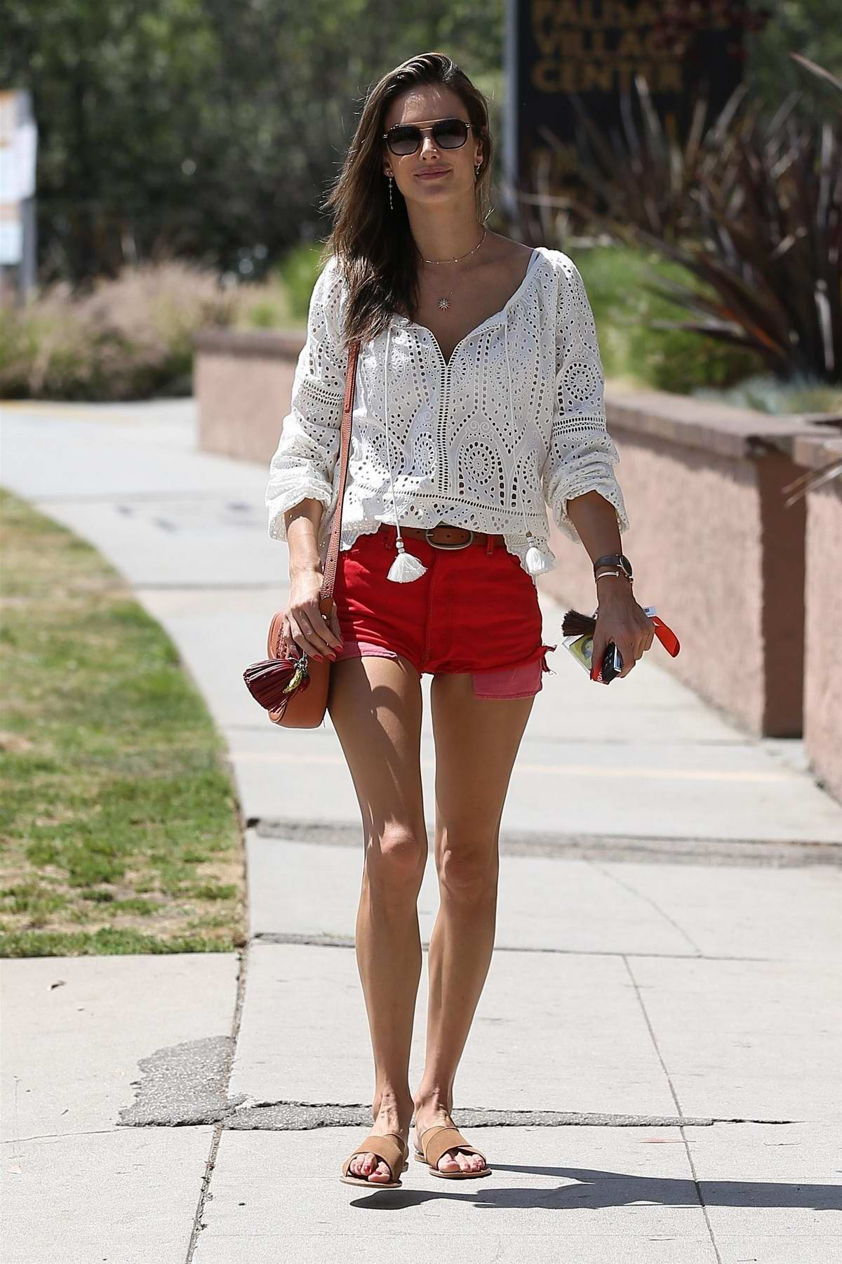 Alessandra Ambrosio wears a pair of red denim shorts and white top while out in Pacific Palisades, California