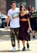 Dua Lipa looks cute in a polka dot dress while out with boyfriend Isaac Carew after a Sushi lunch in New York City