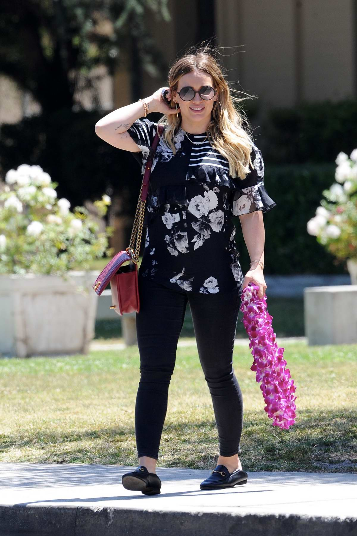 Hilary Duff shows off her baby bump while out with her son and boyfriend Matthew Koma in Studio City, Los Angeles
