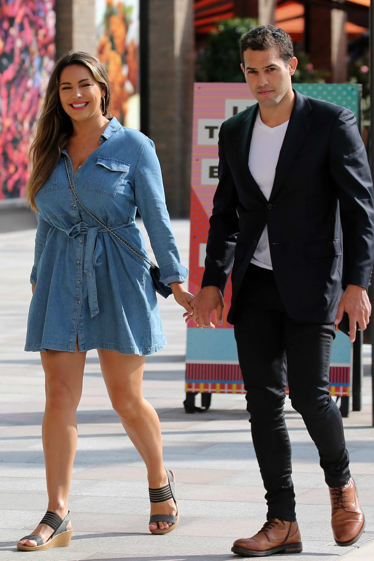 Kelly Brook is all smiles as she leaves ITV Studios holding hands with boyfriend Jeremy Parisi in London, UK