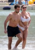 Kelly Brook rocks a white bikini at the beach while on holiday with boyfriend Jeremy Parisi in Mykonos, Greece