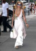 Rita Ora spotted in a low cut silk dress while running errands in New York City