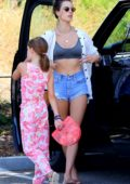 Alessandra Ambrosio shows off her summer style in an unbuttoned white shirt and denim shorts as she arrives at the Malibu Country Mart, California