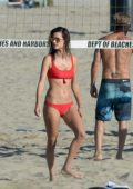 Alessandra Ambrosio slips into a red bikini while playing beach volleyball with friends in Los Angeles