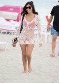 Alexandra Rodriguez wears a red bikini while soaking up the sun at the beach in Miami, Florida