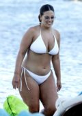 Ashley Graham wears a white bikini as she spends some time at the beach with her friends in Mykonos, Greece