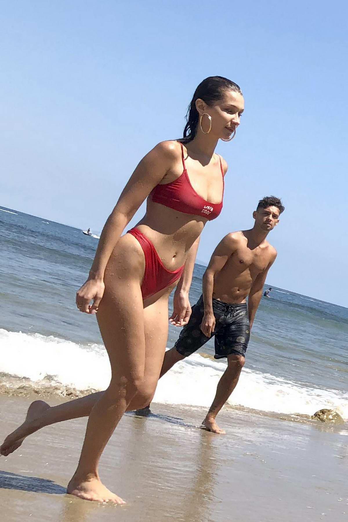 Bella Hadid goes for swim wearing a red bikini on 04th of July in Malibu, California