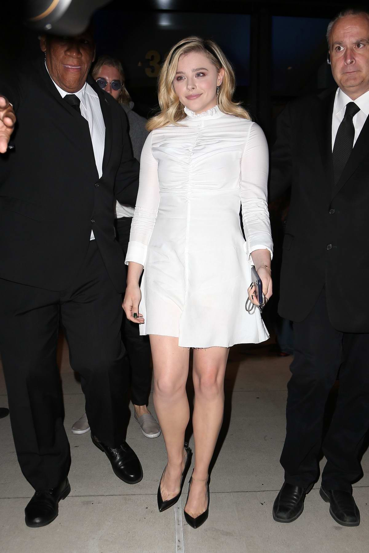 Chloe Grace Moretz spotted leaving Cadillac House in a beautiful white mini dress in New York City
