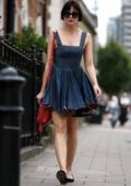 Daisy Lowe seen sporting her new short hair look in a mini denim dress in Central London, UK