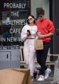 Dua Lipa and boyfriend Isaac Carew share a kiss on the streets of New York City