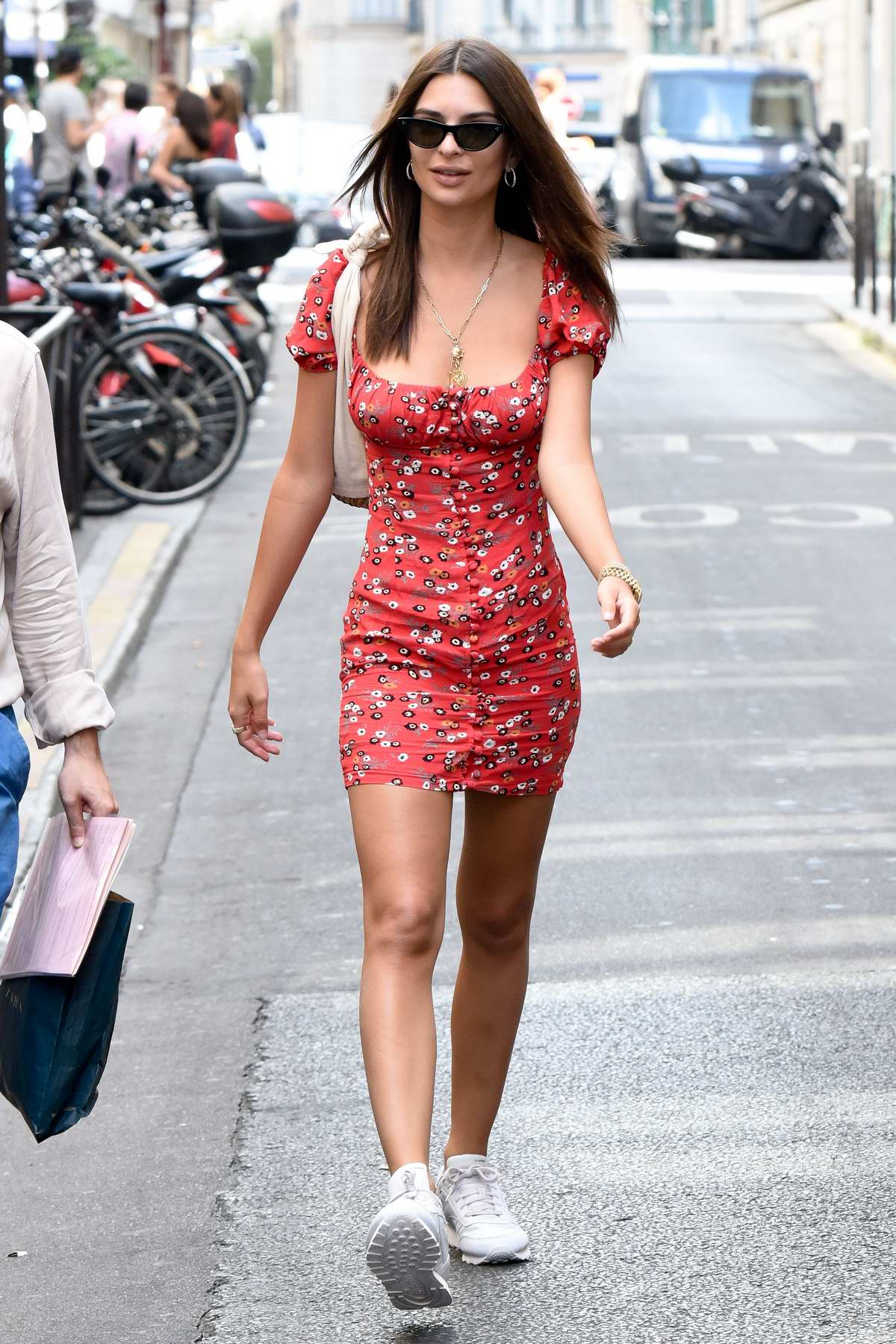 Emily Ratajkowski seen in a short red dress while out sightseeing in Paris, France