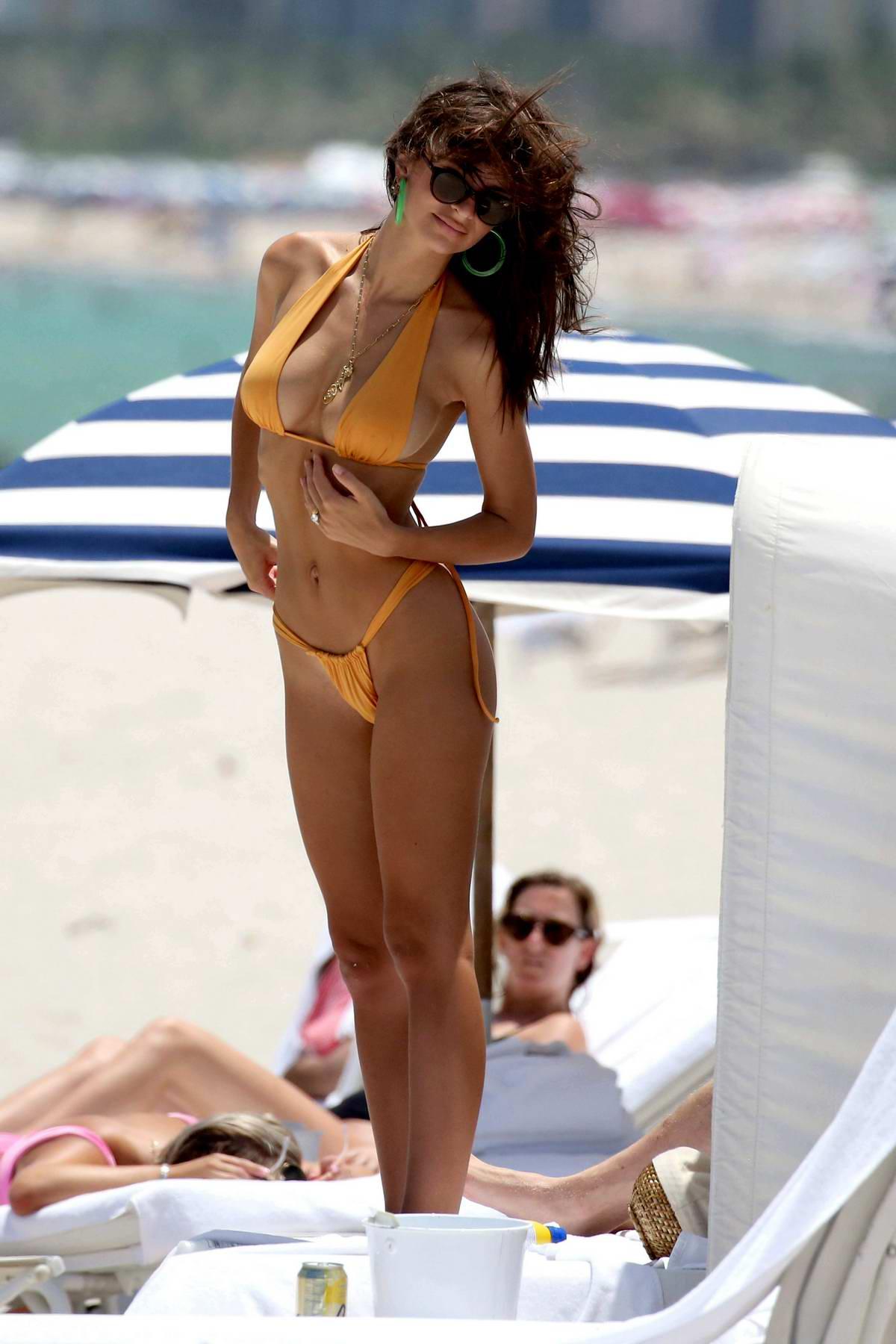 emily ratajkowski sizzles in an orange bikini during a relaxing beach day with husband sebastian bear-mcclard in miami, florida-210718_#