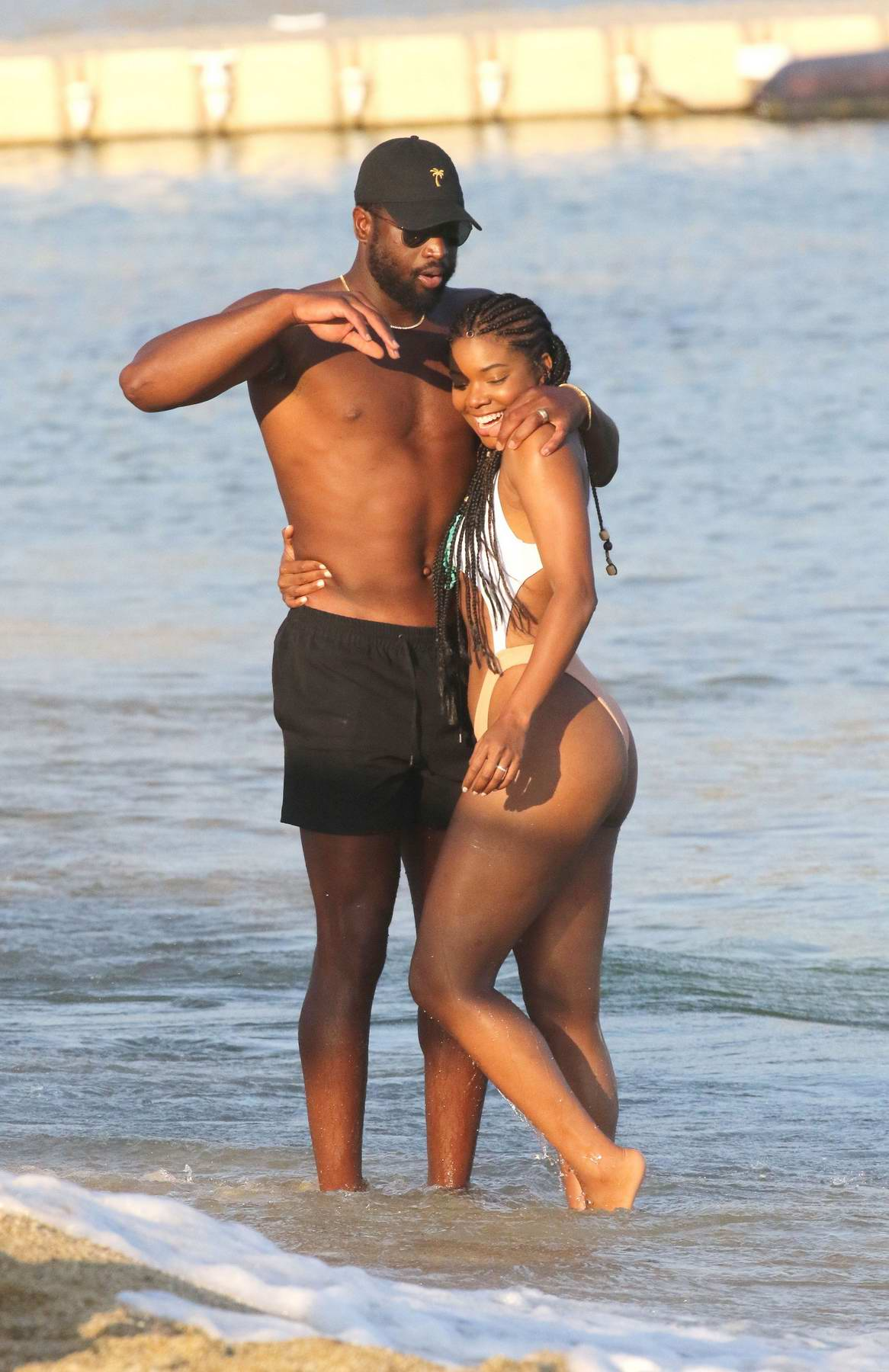 Gabrielle Union wears a bi-color bikini as she spends a ...