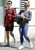 Gemma Atkinson grabs a post workout smoothie as she leaves a gym with Gorka Marquez in Manchester City Centre, Manchester, UK