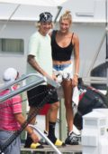 Hailey Baldwin and Justin Bieber are spotted on a boat as they arrive on their post engagement trip in The Bahamas