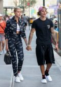 Hailey Baldwin and Justin Bieber hold hands as they leave Nobu restaurant in New York City