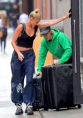 Hailey Baldwin and Justin Bieber seen pushing a couple of large suitcases as they left the Milk Studios in New York City