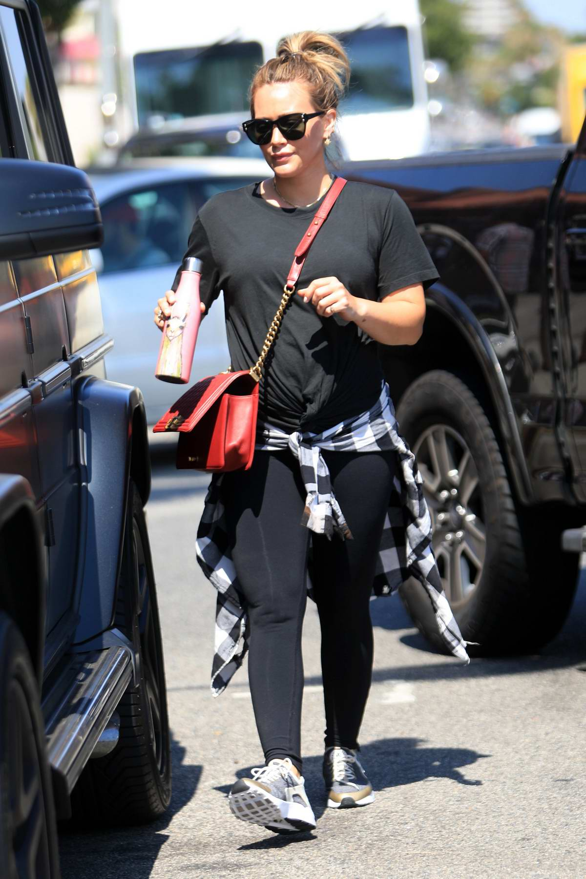 Hilary Duff dressed in all black seen leaving lunch with a friend in Los Angeles