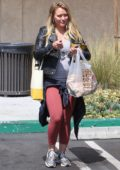 Hilary Duff steps out in black leather jacket and peach leggings to grab some lunch to-go in Studio City, Los Angeles